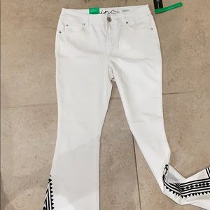 White inc denim jeans with black pattern.